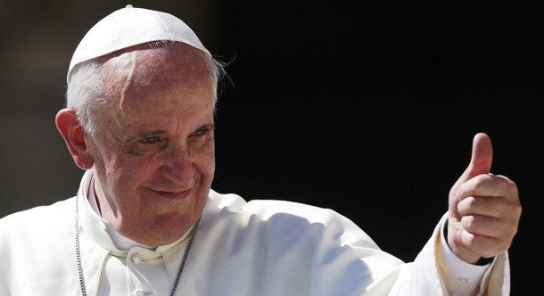 Pope Francis waves as he leads his weekly audience in Saint Peter's Square at the Vatican