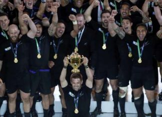 McCaw of New Zealand holds up the Webb Ellis trophy after winning the Rugby World Cup Final against Australia at Twickenham in London