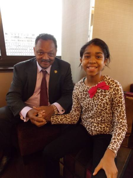 Zuriel Oduwole with the Revd Jesse Jackson