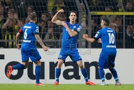 Paderborn players celebrating their goal, not oblivious of the hurricane Dortmund