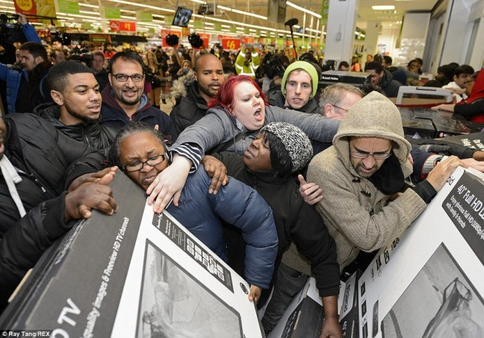Scrum_down_Customers_push_each_other_out_of_the_way_as_the_crowd_Black_Friday