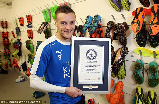 Jamie vardy with his Guinness World Records certificate