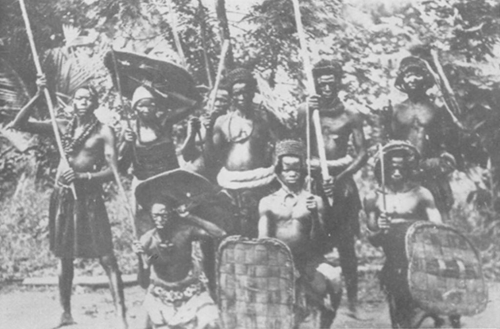 A group of I[g]bo warriors in ancient battle ready war costume 1956