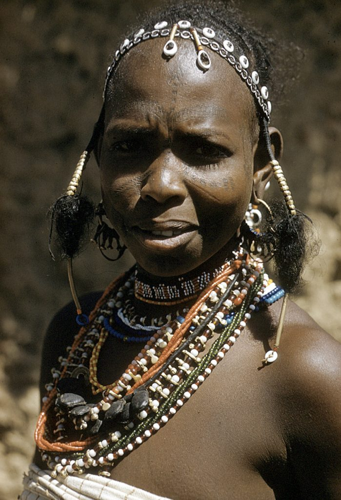 Fulbe women with brightly tasseled hat, Zaranda village, east of Jos, Nigeria