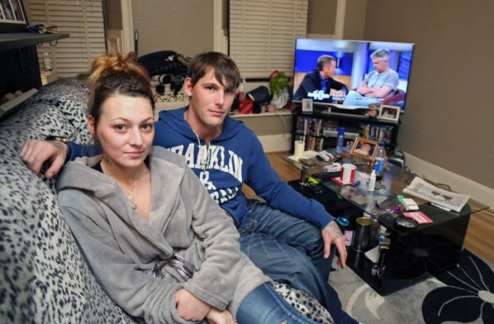 lottery couple in their flat facing eviction