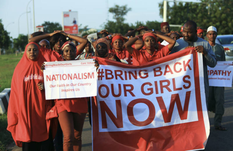 """""""#Bring Back Our Girls"""" campaigners participate in a lamentation parade, as more towns in Nigeria come under attack from Boko Haram in Abuja, November 3, 2014. Violence in Nigeria's northeast has been on the rise since the government announced a ceasefire with the rebels nearly two weeks ago to pursue talks in neighboring Chad aimed at freeing more than 200 girls kidnapped in April. Boko Haram's leader said the girls had been """"married off"""" to his fighters, contradicting an earlier announcement of a deal to release them. REUTERS/Afolabi Sotunde (NIGERIA - Tags: POLITICS CIVIL UNREST) - RTR4COOJ"""