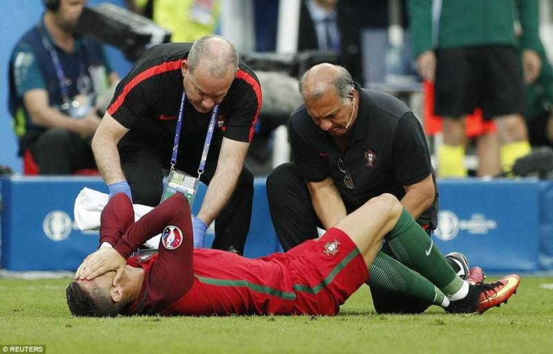 Reuters - Ronaldo being attended to by medics