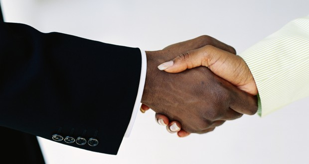 black business people shaking hands