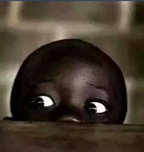 black child peeking 2 (5 types of Football fans you will find at viewing centres in Nigeria)