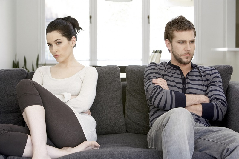 Couple sitting on sofa looking angry  (Relationship Musings ~ Matters Of The Heart)