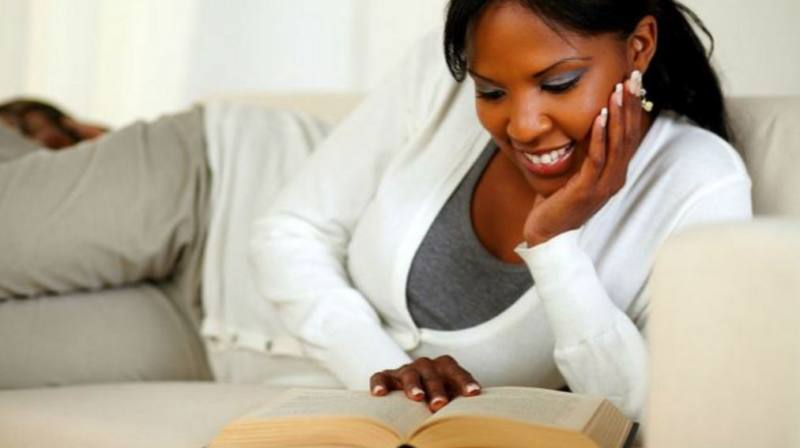 black-woman-reading (6 SIMPLE LIFE CHANGING THINGS TO DO THIS NOVEMBER)