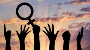 feminism-hands-and-symbol-by-Prazis-Images-via-Shutterstock